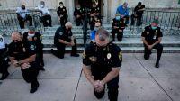 Officers kneel